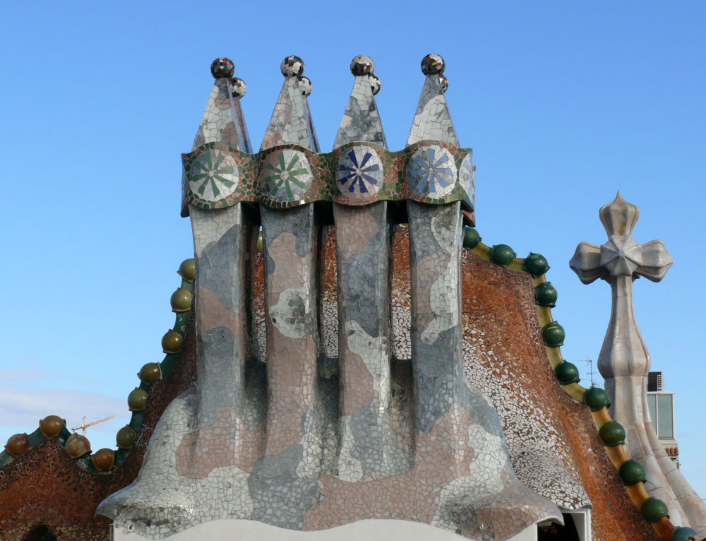 An outstanding quality of all Gaudi's works is that he tried to decorate almost every architectural feature. On the roof of Casa Batllo' chimneys are covered with broken ceramic and painted glass.