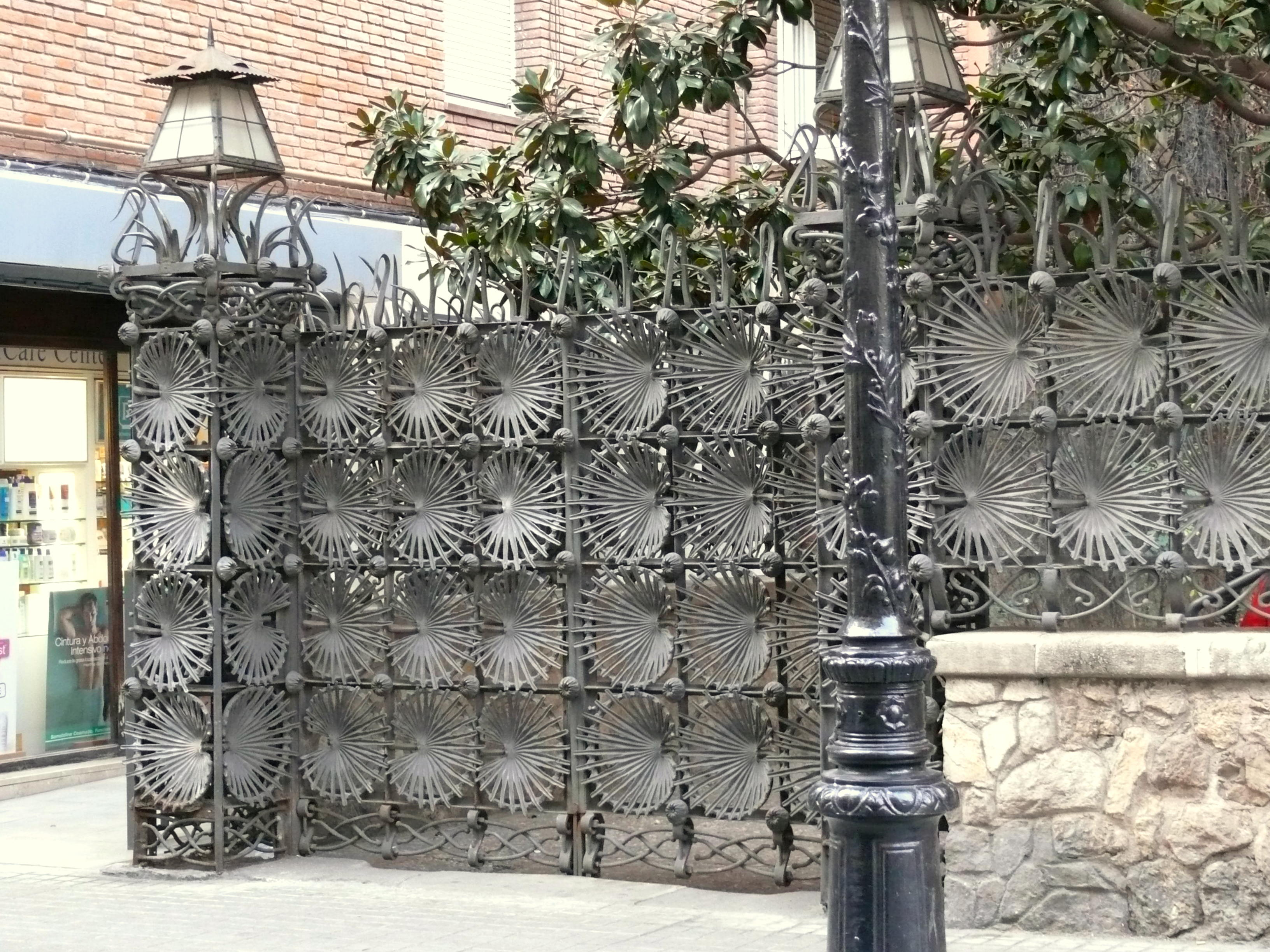 Wrought iron gate  in the Casa Vicens in Barcelona. The main motif of ornament are the palm trees.