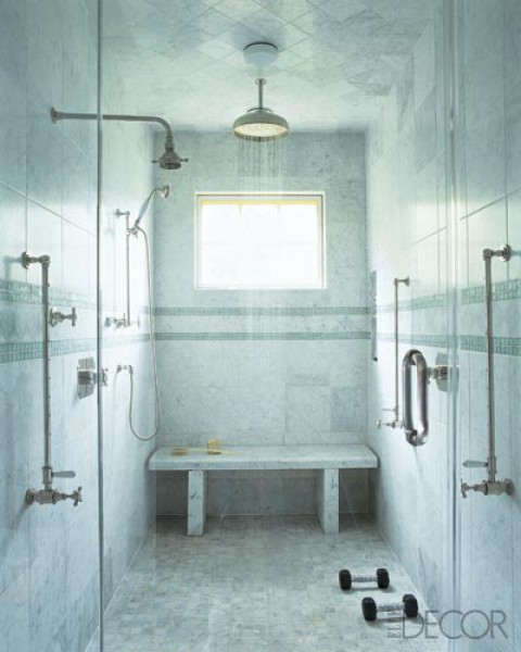 This beautiful shower room is equipped with a seat and grab bars.