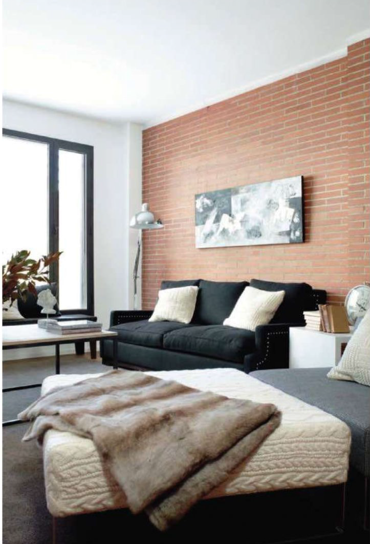 Furs and knitted throw make this loft apartment look cozy