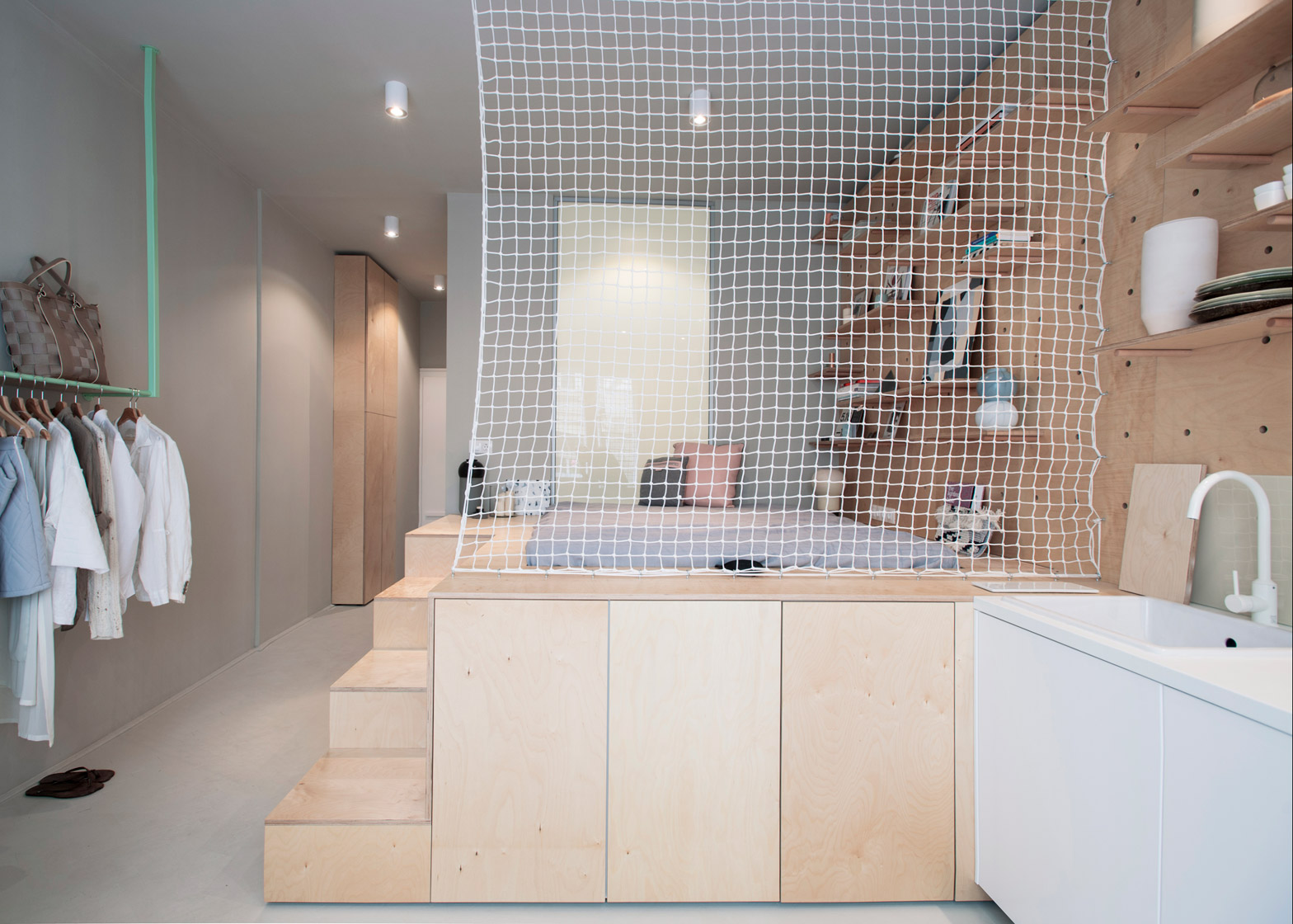 Air-BnP-home_Position-Collective_small-aparment_Budapest_Hungary_plywood_Balazs-Glodi_dezeen_1568_1