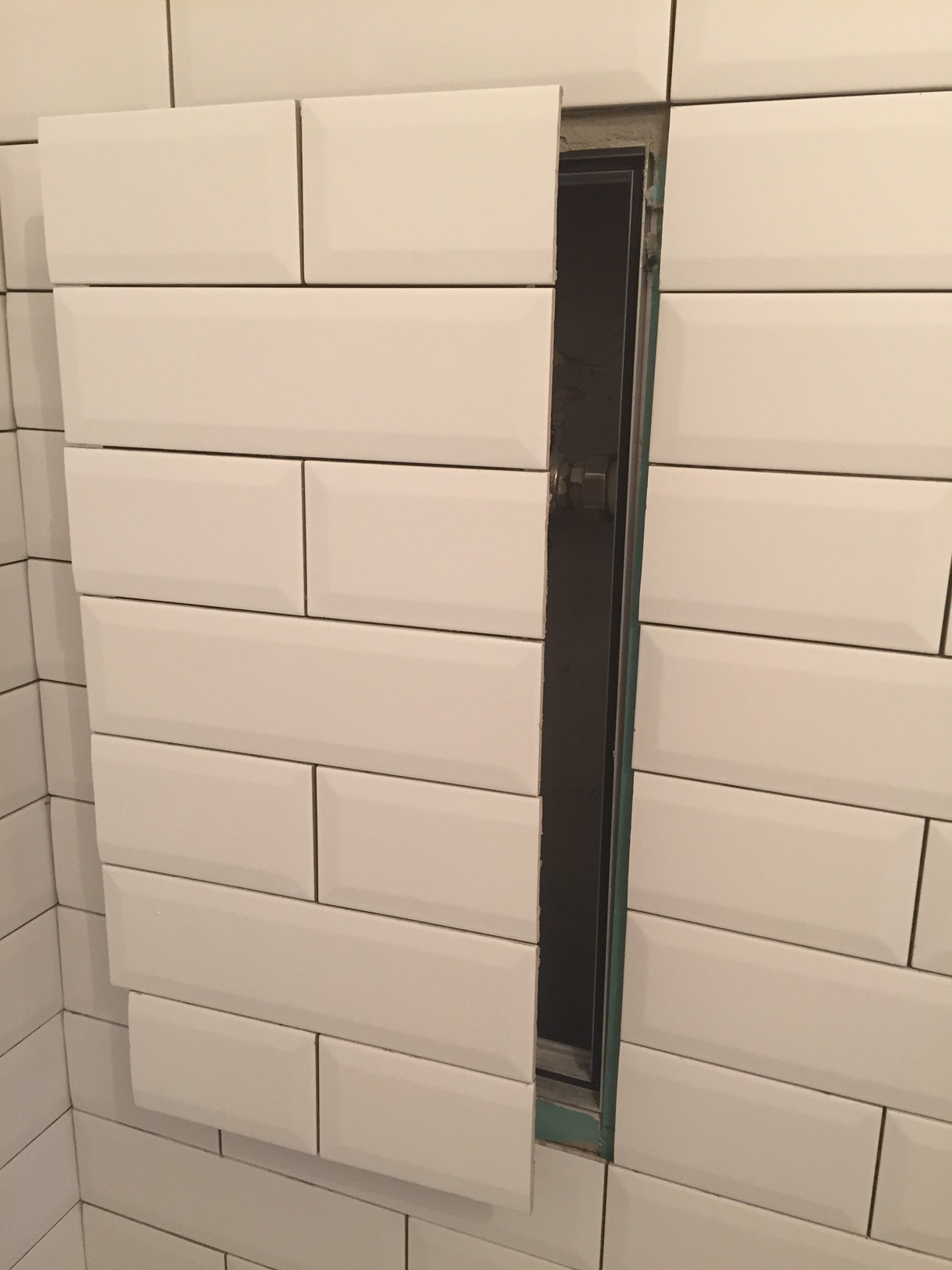 How to Make a Hidden Access Panel With Subway Tiles - L\' Essenziale
